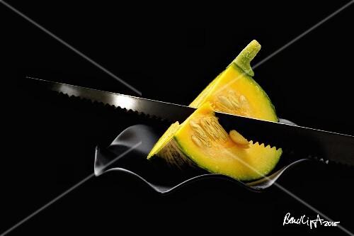 A pumpkin wedge with a saw