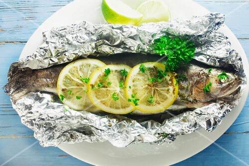 Trout with lemon and herbs in aluminium foil