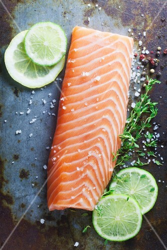 Raw salmon fillet on a metal surface