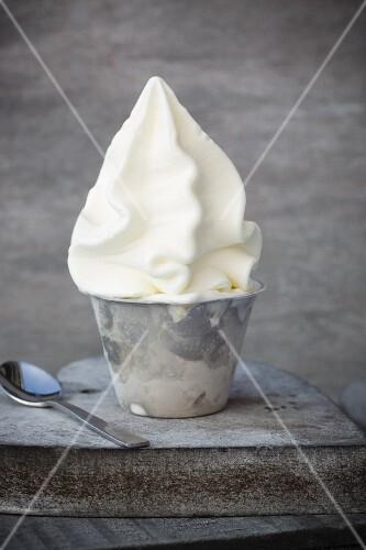 Frozen yoghurt in a metal cup