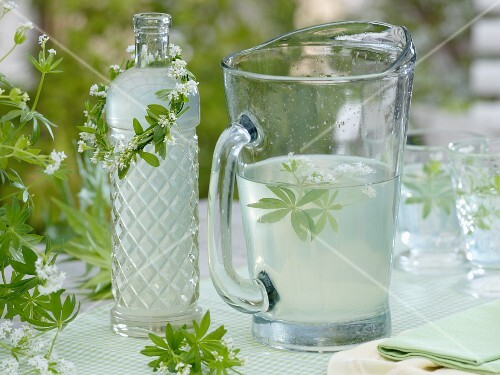 Lemonade with woodruff and a wreath around a bottle