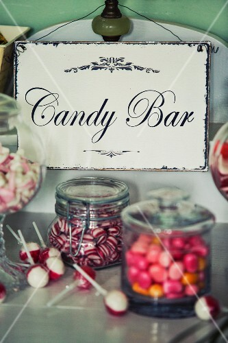 Candy buffet bar with vintage enamel sign