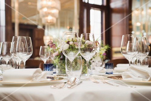 Restaurant table set with glasses