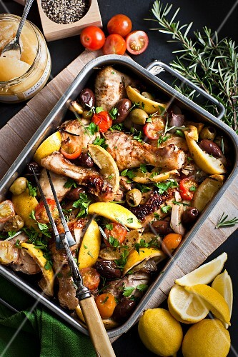Lemon chicken with herbs, olives and tomatoes