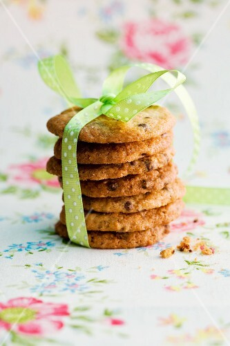 A stack of chocolate chip cookies with a ribbon