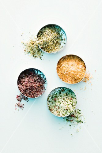 Various types of spicy salts in dishes (seen from above)