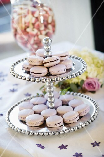 Lilac-coloured macaroons on a cake stand at a wedding