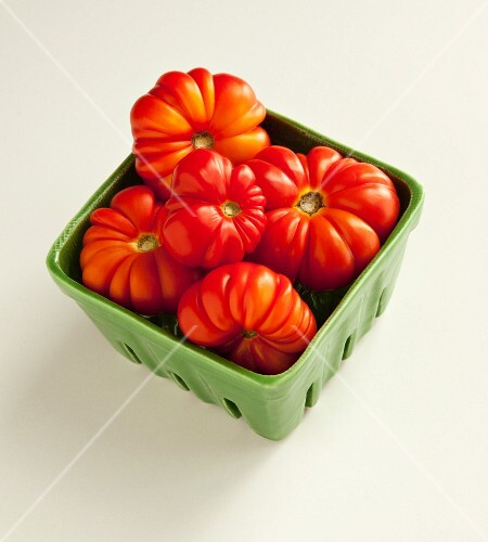 Heirloom tomatoes in a ceramic dish