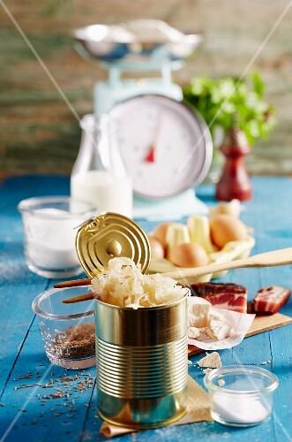 A tin of sauerkraut and various ingredients