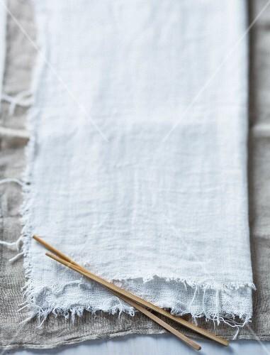 Chopsticks on a linen cloth