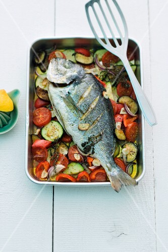Seabream on a bed of vegetables