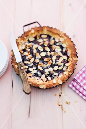 Linzertorte (nut and jam layer cake) with flaked almonds
