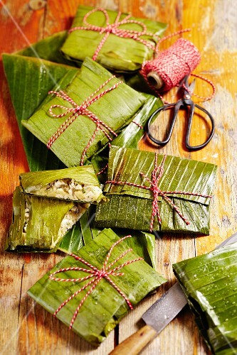 Tamales (corn packages wrapped in banana leaves, Mexico)