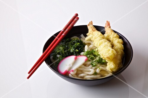Nabe (Japanese stew) with udon noodles with prawn tempura