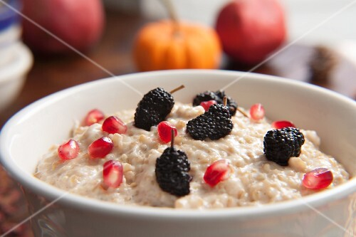 Porridge with mulberries and pomegranate seeds