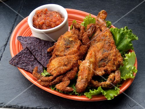 Fried soft shell crabs with tortilla chips and salsa