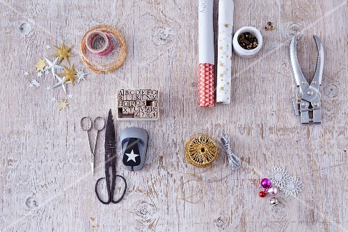 Various craft utensils for wrapping Christmas presents