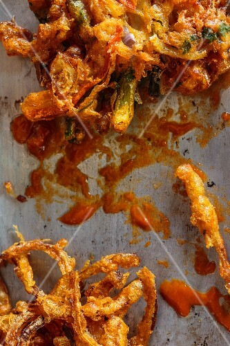 Vegetable fritters with sriracha sauce
