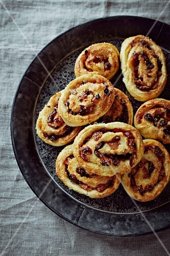 Freshly baked Christmas buns with dried fruit and spices