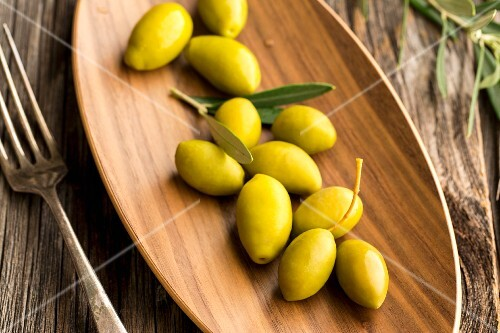 Fresh olives on a wooden dish