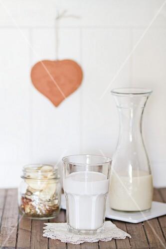 Vegan milk in a glass and a carafe