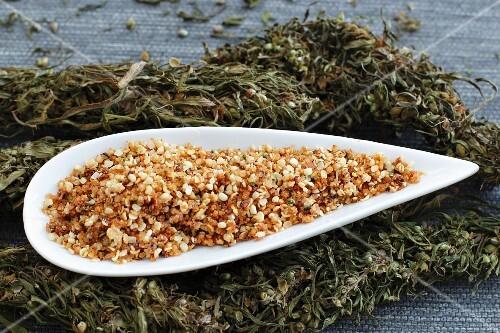 Dried hemp and a bowl of caramelised hemp seeds