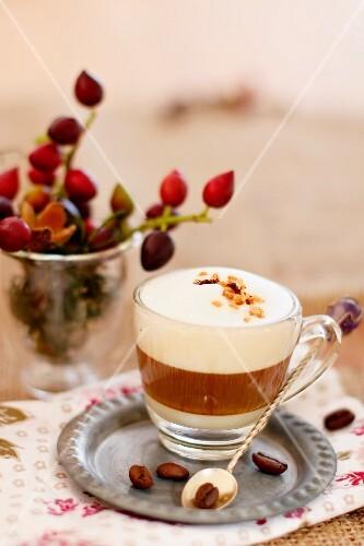 An espresso macchiato in a glass cup
