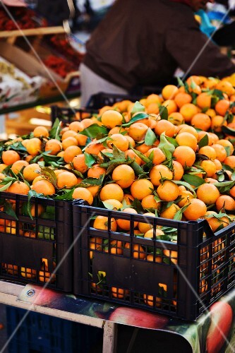 Clementines in crates at a market (Italy)