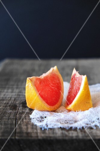 Two slices of pink grapefruit