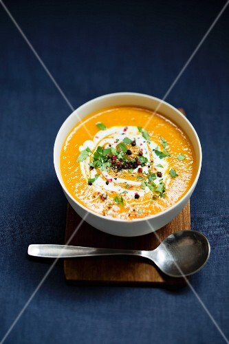 Carrot soup with colourful pepper