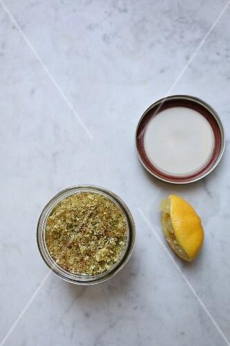 Elderflowers in a jar with vodka and lemon juice