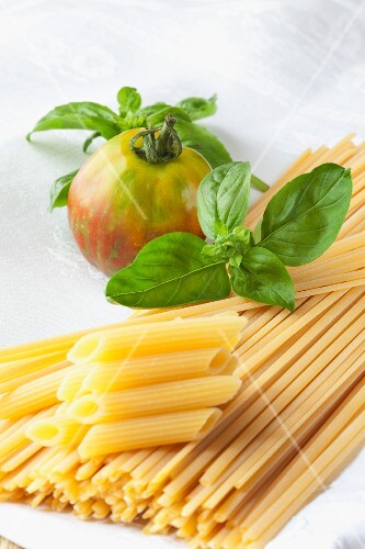 Linguine, penne, basil and an organic tomato