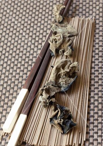 Soba noodles, dried mu-err mushrooms and chopsticks