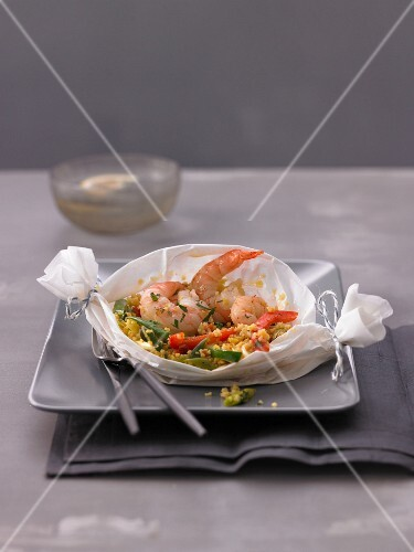 Couscous with prawns in a parchment paper