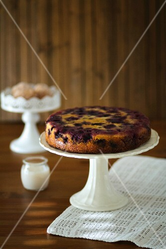 Blueberry cake on a white cake stand