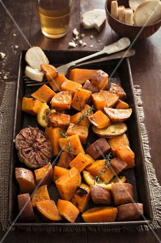 Roasted sweet potatoes with garlic, lemon and herbs