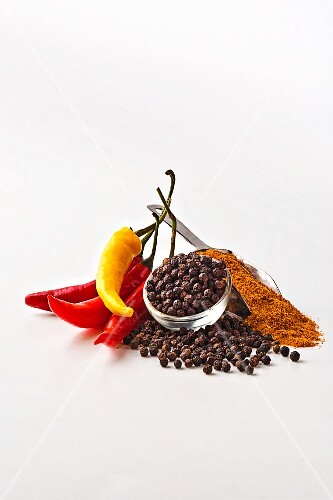 Chilli pepper and spices on a white surface