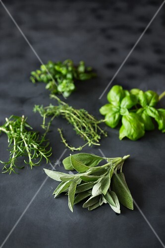 Fresh herbs on a dark surface