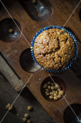 A butterscotch muffin with apple