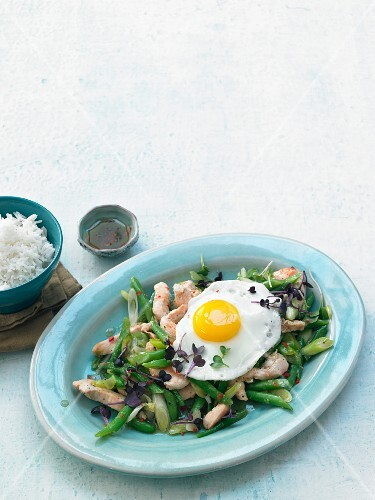 Stir-fried chicken with a fried egg