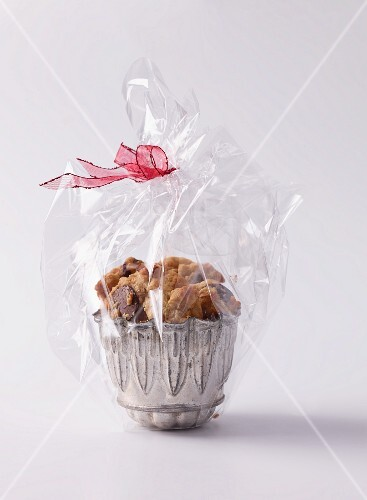 Peanut and chocolate cookies wrapped in cellophane as a gift