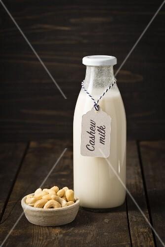 Cashew nut milk in a glass bottle