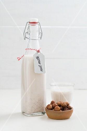 Hazelnut milk in a glass bottle