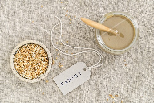 A jar of tahini (sesame seed paste), seen from above