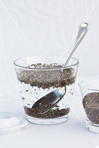 Chia seeds being softened in salt water