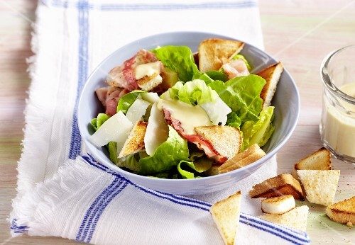Caesar salad with toast triangles
