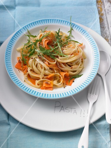 Tagliatelle with carrots, ginger, pine nuts and rocket