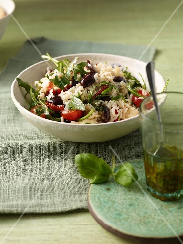 Italian rice salad with dried tomatoes and olives