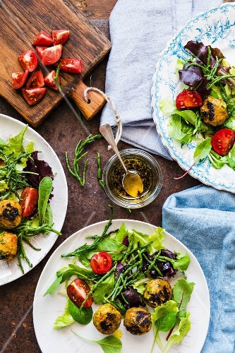 A salad with black tomatoes, samphire and vegetarian meatballs