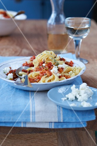Spaghetti with vegetable bolognese and sheep's cheese